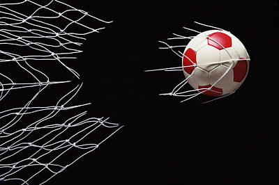 Soccer Ball Photograph - Soccer Ball Breaking Through Goal Net by Phillip Simpson Photographer