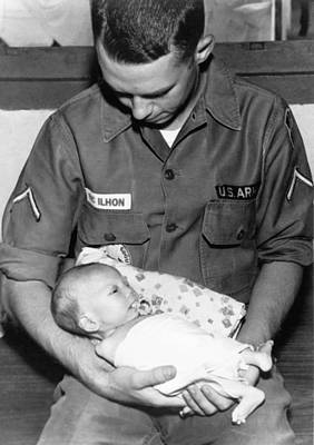 Man Holding Baby Photograph - Soldier At Orphanage by Underwood Archives