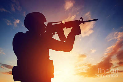 Silhouetted Photograph - Soldier Shooting With His Rifle At Sunset by Michal Bednarek