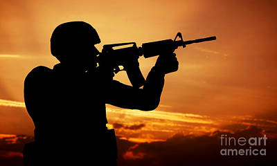 Soldier Shooting With His Weapon At Sunset Art Print by Michal Bednarek