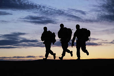 Photograph - Soldiers Of The 20th Cbrne Conduct A 7.5 Mile Ruck by Paul Fearn