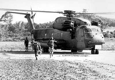Soldiers Run To A Hh-53c Helicopter Art Print by Stocktrek Images