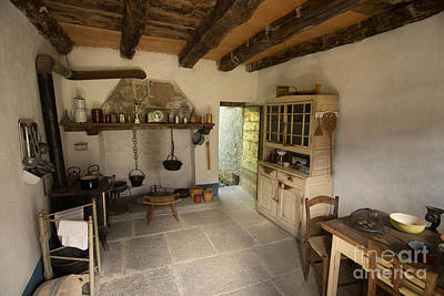 A Historic Italian Farm Kitchen In Southern Switzerland Art Print by Gary Whitton