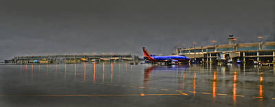 Airlines Photograph - Southwest Plane In The Rain by Don Wolf