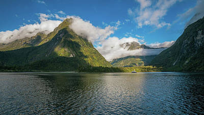 Photograph - Spectacular Mountain Range Surrounded By Clouds Close To Sunset At Milford Sound by Daniela Constantinescu