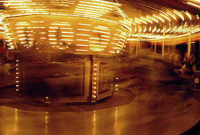 Photograph - Speeding Carousel by Gary Brandes