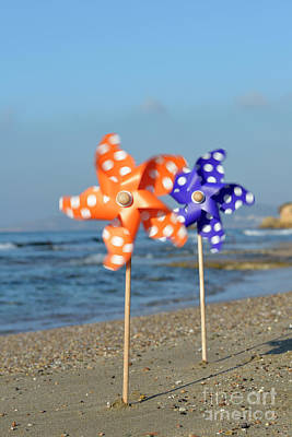 Photograph - Spinning Pinwheels On A Beach by George Atsametakis