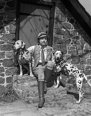 Pet Care Photograph - Sporty Woman With Dalmations, C.1930s by H. Armstrong Roberts/ClassicStock