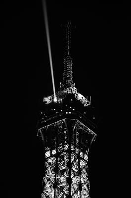 Photograph - Spotlight Extending From Top Of Illuminated Night View Of Eiffel Tower Paris France Black And White by Shawn O'Brien