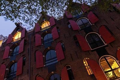 Photograph - Springtime Amsterdam - Bright Red Window Shutters In The Evening Breeze - Left by Georgia Mizuleva
