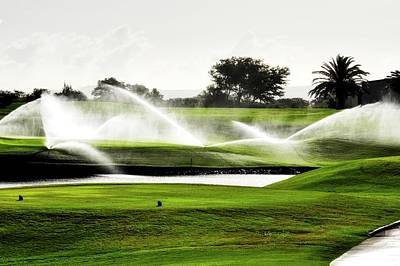 Photograph - Sprinkler Sprays On A Golf Course by Kirsten Giving