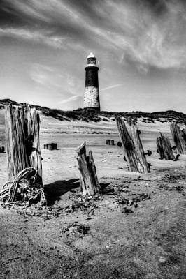 Photograph - Spurn Point Lighthouse And Groynes by Sarah Couzens