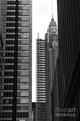 Architecture Photograph - Squeezed In Mono by John Rizzuto