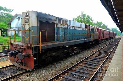 Photograph - Sri Lankan Railways Locomotive Train Engine With Passenger Carriages Parked At Station by Imran Ahmed