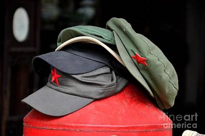 Photograph - Stack Of Communist Mao Style Caps With Red Star by Imran Ahmed