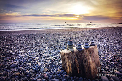 Beach Photos - Stacked Rocks at Sunset by Joan McCool