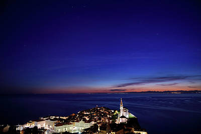 Photograph - Stars Over Piran Slovenia At Night With Lit Tartini Square Court by Reimar Gaertner