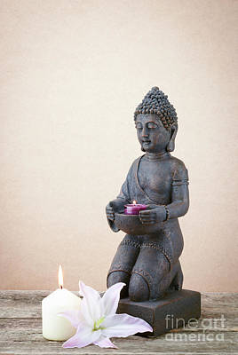Religious Amulet Photograph - Statue Of Buddha With A Candle His Hand by Kira Yan