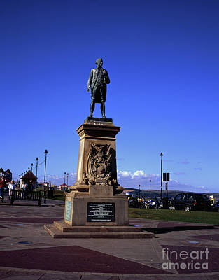 Lake Life - Statue of Captain James Cook overlooking Whitby from The East Terrace Crescent  Yorkshire England by Michael Walters