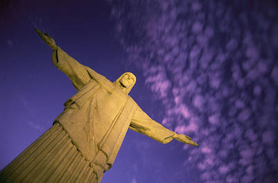 Religious Characters And Scenes Photograph - Statue Of Jesus Christ Against Twilight by Michael Melford