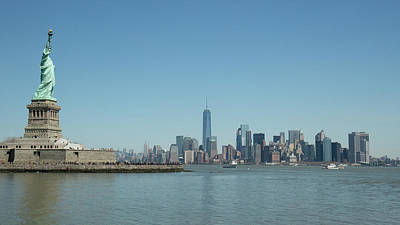 Photograph - Statue Of Liberty And Manhattan by Prashant Meswani