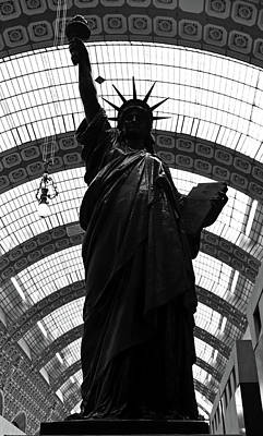 Photograph - Statue Of Liberty In Bronze Silhouetted Against Light Of Glass Ceiling Orsay Museum Black And White by Shawn O'Brien