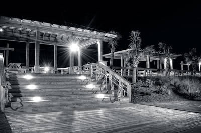 North Carolina Photograph - Steps Up To The Carolina Beach Boardwalk At Night In Black And W by Greg Mimbs