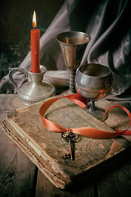 Art Print featuring the photograph Still Life With Old Book And Metal Dishes by Jaroslaw Blaminsky
