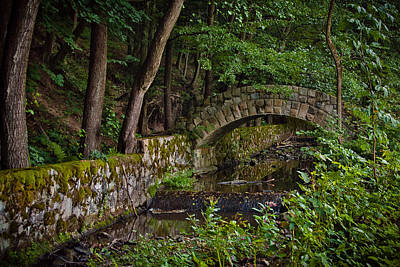 Stone Arch Bridge Path And Flowing Creek Stream In Lush Forest Countryside Landscape Art Print