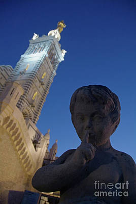 Stone Statue Of A Cherub With View Of The Bell Tower Of Notre Dame De La Garde In Marseille Art Print