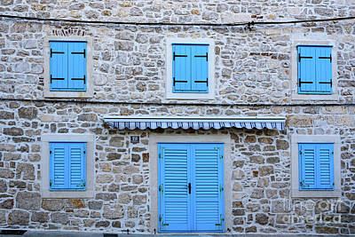 Photograph - Stone Wall With Blue Door And Blue Shuttered Windows In Primosten, Croatia by Global Light Photography - Nicole Leffer