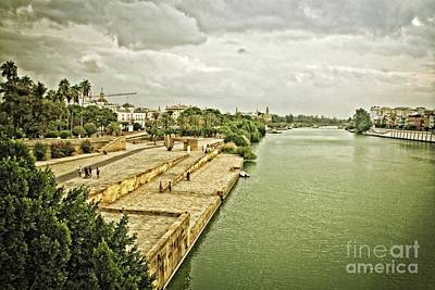 Photograph - Storm Clouds Over The Guadalquivir-seville by Mary Machare
