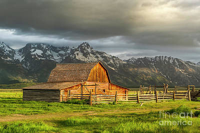 Photograph - Storm Clouds Over The Mormon Barn In Grand Teton National Park by Ronda Kimbrow