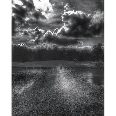 Female Photograph - A Woman Walking Into A Storm  by Phunny Phace