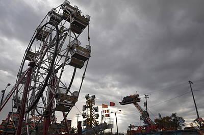 Stormy Ferris Wheel Art Print by Daniel Ness