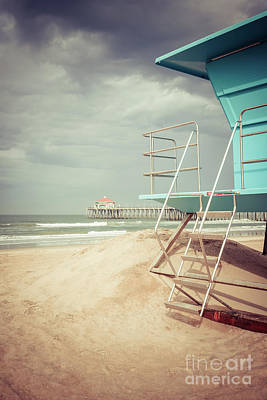 Stormy Huntington Beach Pier And Lifeguard Stand Art Print by Paul Velgos