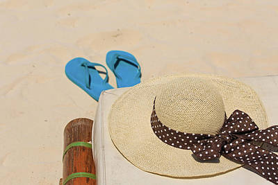 Ocean Photograph - Straw Hat And Flip Flops On Sand Beach by NadyaEugene Photography
