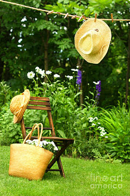 Straw Hat Hanging On Clothesline Art Print by Sandra Cunningham