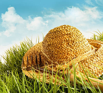 Outdoor Still Life Photograph - Straw Hat On Grass With Blue Sky  by Sandra Cunningham