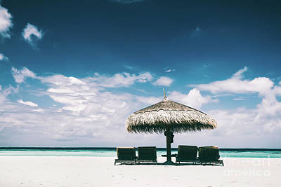 Photograph - Straw Umbrella And Sunbeds On A Sandy Beach by Michal Bednarek