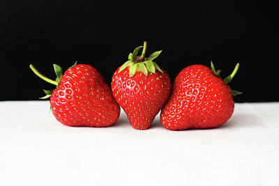 Photograph - Strawberries On Black Over White by Alan Harman