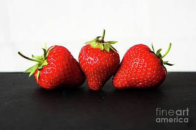 Photograph - Strawberries On White Over Black by Alan Harman