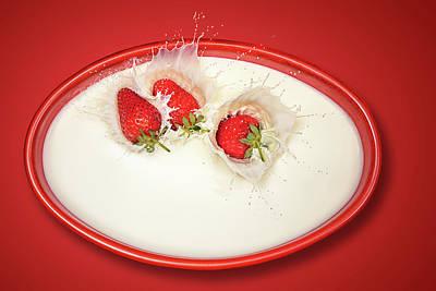 Strawberry Photograph - Strawberries Splashing In Milk by Johan Swanepoel