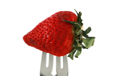 Strawberry On A Fork Art Print by Michael Ledray