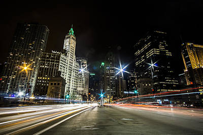 streaks of light zooming by you  on Chicago's Mag Mile Art Print by Sven Brogren