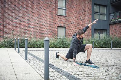 Photograph - Streching. Urban Outdoor Activities. by Michal Bednarek