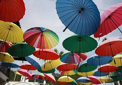 Photograph - Street Decorated With Colored Umbrellas by Taiche Acrylic Art
