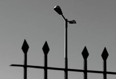 Photograph - Street Lamp And Iron Metal Fence by Prakash Ghai