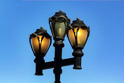 Photograph - Street Lamps - Daytime by Robert Ullmann