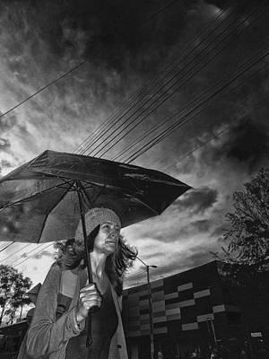 Walking Into The Dark Rain Art Print by Daniel Gomez